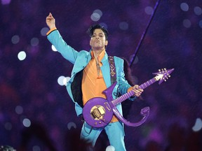 In this Feb. 4, 2007, file photo, Prince performs during the halftime show at Super Bowl XLI at Dolphin Stadium in Miami.