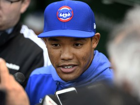 Chicago Cubs shortstop Addison Russell speaks to the media in the dugout before a baseball game against the Miami Marlins, Wednesday, May 8, 2019, in Chicago. Russell rejoins the team after completing a 40-game suspension for violating Major League Baseball's domestic violence policy and spending extra time in the minors to get ready.