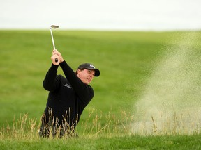 Phil Mickelson of the United States plays a shot from a bunker on the 11th hole during the third round of the 2019 U.S. Open at Pebble Beach Golf Links on June 15, 2019 in Pebble Beach, California.