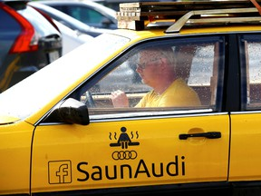 Willem Maesalu, inventor and owner of the old yellow Audi car converted into a small sauna, drives in the parking lot in Tallinn, Estonia June 27, 2019. REUTERS/Ints Kalnins