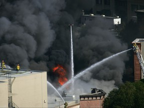 Approximately 300 firefighters battle a huge fire on the backlot of Universal Studios on June 1, 2008 in Universal City, Calif. (Photo by David McNew/Getty Images)