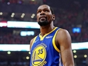 Golden State Warriors forward Kevin Durant reacts during the second quarter against the Toronto Raptors in Game 5 of the NBA Finals at Scotiabank Arena.