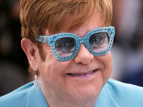 """Singer and producer Elton John poses during a photocall for the film """"Rocketman"""" out of competition. (REUTERS/Stephane Mahe/File Photo)"""