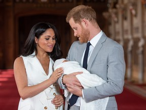 WINDSOR, ENGLAND - MAY 08: Prince Harry, Duke of Sussex and Meghan, Duchess of Sussex, pose with their newborn son Archie Harrison Mountbatten-Windsor during a photocall in St George's Hall at Windsor Castle on May 8, 2019 in Windsor, England. The Duchess of Sussex gave birth at 05:26 on Monday 06 May, 2019.
