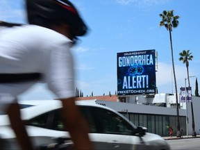 A billboard from the AIDS Healthcare Foundation (AHF) is seen on Sunset Boulevard in Hollywood, California on May 29, 2018 warning of a drug resistant Gonorrhea. (FREDERIC J. BROWN/AFP/Getty Images)