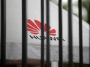 A Huawei logo is seen outside the fence at its headquarters in Shenzhen, Guangdong province, China May 29, 2019.