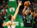Kyrie Irving of the Boston Celtics shoots the ball over Bojan Bogdanovic of the Indiana Pacers at TD Garden on April 14, 2019 in Boston. (Adam Glanzman/Getty Images)