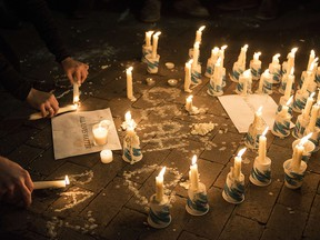 A makeshift memorial is made during a vigil at the University of North Carolina following the murders of three Muslim students on February 11, 2015 in Chapel Hill, North Carolina. (BRENDAN SMIALOWSKI/AFP/Getty Images)