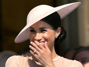 Meghan, Duchess of Sussex attends a garden party at Buckingham Palace, in London, Britain May 22, 2018.