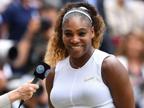 US player Serena Williams is interviewed during the presentation after losing against Romania's Simona Halep during their women's singles final on day twelve of the 2019 Wimbledon Championships at The All England Lawn Tennis Club in Wimbledon, southwest London, on July 13, 2019.