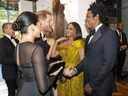 Britain's Prince Harry, Duke of Sussex and Britain's Meghan, Duchess of Sussex meet cast and crew, including US singer-songwriter Beyoncé and her husband, US rapper Jay-Z  as they attend the European premiere of the film The Lion King in London on July 14, 2019.
