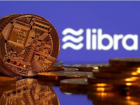 Representations of virtual currency are displayed in front of the Libra logo in this illustration picture, June 21, 2019.
