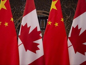 Canadian and Chinese flags are on display prior to a meeting with Canada's Prime Minister Justin Trudeau and China's President Xi Jinping at the Diaoyutai State Guesthouse in Beijing on Dec. 5, 2017.