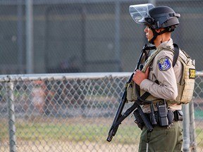 A police officer stands watch at the scene of a mass shooting during the Gilroy Garlic Festival in Gilroy, California, July 28, 2019. (REUTERS/Chris Smead)