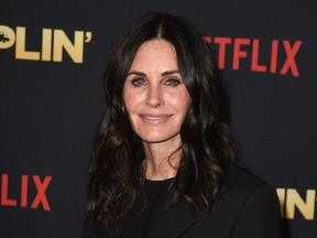 """Courteney Cox arrives at the premiere of Netflix's """"Dumplin'"""" at the Chinese Theater on December 6, 2018 in Los Angeles, California. Kevin Winter/Getty Images"""