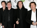 The Kinks band members, left to right, Ray Davies, Mick Avory, Dave Davies and Peter Quaife pose backstage with the award for their induction into the U.K. Music Hall Of Fame 2005 at Alexandra Palace on Nov. 16, 2005 in London. (MJ Kim/Getty Images)