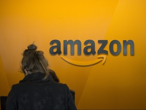 A visitor checks in at the Amazon corporate headquarters on June 16, 2017 in Seattle, Wash.
