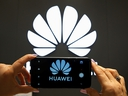 A Huawei logo is seen on a cell phone screen in their store at Vina del Mar, Chile July 18, 2019. (REUTERS/Rodrigo Garrido)