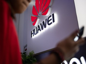 In this file photo taken on May 27, 2019, a Huawei logo is displayed at a retail store in Beijing.