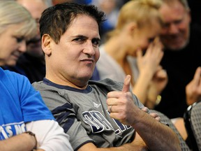 Dallas Mavericks owner Mark Cuban gives a thumbs up while watching his team take on the Miami Heat at the American Airlines Center. (File photo)