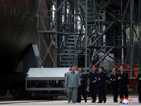 North Korean leader Kim Jong Un visits a submarine factory in an undisclosed location, North Korea, in this undated picture released by North Korea's Central News Agency (KCNA) on July 23, 2019.