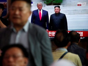 South Korean people watch a live TV broadcast on a meeting between North Korean leader Kim Jong Un and U.S. President Donald Trump at the truce village of Panmunjom inside the demilitarised zone separating the two Koreas, in Seoul, South Korea, June 30, 2019.