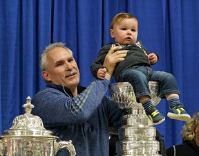 Calahoo resident Braxton Majeau, 13 months, poses for a photo with St. Louis Blues head coach Craig Berube in the hamlet of Calahoo northwest of Edmonton on Tuesday, July 2, 2019. Berube brought the Stanley Cup and the Campbell Conference Championship trophy to his home town after his team won the NHL Stanley Cup championship.