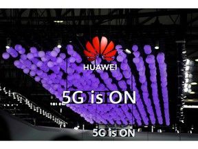 A Huawei logo and a 5G sign are pictured at Mobile World Congress (MWC) in Shanghai, China June 28, 2019.