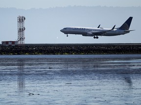 A United Airlines Boeing 737 lands at San Francisco International Airport on April 24, 2019 in San Francisco.