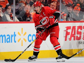 Justin Williams of the Carolina Hurricanes takes the puck in the third period against the Philadelphia Flyers at Wells Fargo Center on Jan. 3, 2019 in Philadelphia.
