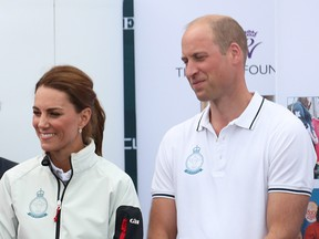Prince William and Catherine, the Duchess of Cambridge watch on as Bear Grylls is awarded the King's Cup during the prize giving following the the King's Cup Regatta in Cowes, the Isle of Wight, Britain August 8, 2019. (Andrew Matthews/REUTERS)
