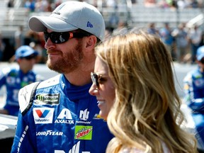 Dale Earnhardt Jr., driver of the #88 Nationwide Chevrolet, stands with his wife Amy on the grid prior to the Monster Energy NASCAR Cup Series Overton's 301 at New Hampshire Motor Speedway on July 16, 2017 in Loudon, N.H.