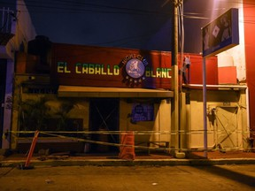 The Caballo Blanco bar (White Horse bar), where 23 people were killed by a fire, is seen cordoned off, in Coatzacoalcos, Veracruz State, Mexico, on Wednesday, Aug. 28, 2019.