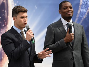 Presenters Colin Jost and Michael Che roll out the gold carpet for the 70th Emmy Awards at Microsoft Theater on Sept. 13, 2018, in Los Angeles.