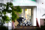 A man operates a police robot near the site of a shooting in al-Noor Islamic centre mosque, near Oslo, Norway, on Saturday, Aug. 10, 2019.