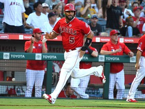 Los Angeles Angels first baseman Albert Pujols scores a run on a double by third baseman David Fletcher (6) in the fourth inning of the game against the Pittsburgh Pirates at Angel Stadium of Anaheim.
