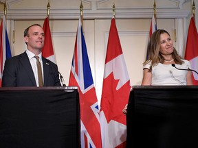 Britain's Secretary of Foreign Affairs Dominic Raab and  Foreign Affairs Minister Chrystia Freeland at a news conference after the two met in Toronto, Ontario, Aug. 6, 2019.