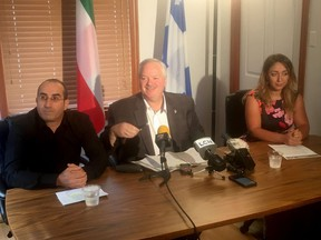 Toufik Benhamiche, left to right, Bloc Quebecois MP Luc Theriault and Kahina Bensaadi, Toufik's wife, answer reporters questions in Mascouche, Que., Friday, Sept. 6, 2019.