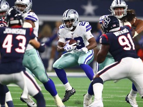 Dallas Cowboys running back Alfred Morris runs with the ball in the second quarter against the Houston Texans at AT&T Stadium.