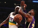 Jrue Holiday of the New Orleans Pelicans looks for a pass against LeBron James #23 of the Los Angeles Lakers during the first half at Staples Center on February 27, 2019 in Los Angeles, California. (Yong Teck Lim/Getty Images)