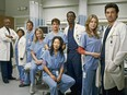 """(From left): James Pickens Jr., Chandra Wilson, Justin Chambers, Katherine Heigl, T.R. Knight (rear), Sandra Oh, Isaiah Washington, Ellen Pompeo and Patrick Dempsey are seen in a 2005 promotional shot for """"Grey's Anatomy."""""""
