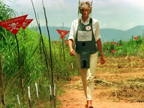 Diana, Princess of Wales, is seen in this Jan. 15 1997 file picture walking in one of the safety corridors of the land mine fields of Huambo, Angola, during her visit to help a Red Cross campaign to outlaw landmines worldwide. (Reuters)
