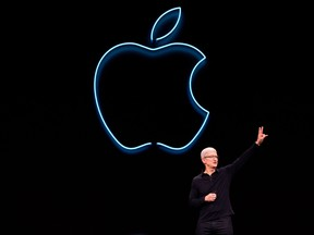 In this file photo taken on June 3, 2019 Apple CEO Tim Cook presents the keynote address during Apple's Worldwide Developer Conference (WWDC) in San Jose, Calif.