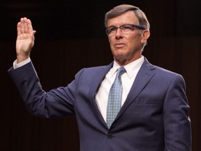 In this file photo taken on July 25, 2018, nominee for director of the National Counterterrorism Center, Joseph Maguire, is sworn in during his confirmation hearing before the Senate Intelligence Committee on Capitol Hill in Washington, D.C.