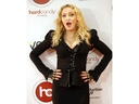 Madonna arrives to launch her new Toronto gym Hard Candy and poses for media on Tuesday February 11, 2014.