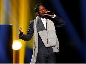 """A$AP Rocky performs """"I'm Not the Only One"""" with Sam Smith (not pictured) during the 42nd American Music Awards in Los Angeles, California November 23, 2014."""