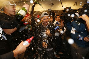 Gleyber Torres #25 of the New York Yankees celebrates with teammates in the locker room after sweeping the Minnesota Twins 3-0 in the American League Division Series to advance to the American League Championship Series at Target Field on October 07, 2019 in Minneapolis, Minnesota. (Photo by Elsa/Getty Images)