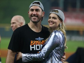 Justin Verlander of the Houston Astros and Kate Upton celebrate the 6-1 win over the Tampa Bay Rayst in game five of the American League Division Series at Minute Maid Park on October 10, 2019 in Houston, Texas.