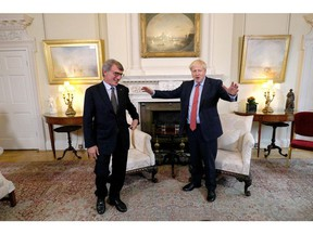 Britain's Prime Minister Boris Johnson (R) interacts with European Parliament president David Sassoli prior to a private meeting at 10 Downing Street for a meeting in London on Oct. 8, 2019.