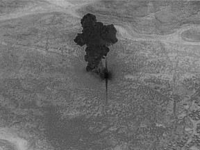 This still image from video released by the U.S. Department of Defense on Wednesday, Oct. 30, 2019, shows smoke rising from the compound of ISIS leader Abu Bakr al-Baghdadi in Syria after it was destroyed in the U.S. raid on Oct. 26.